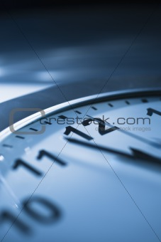 Clock that reads one minute to twelve