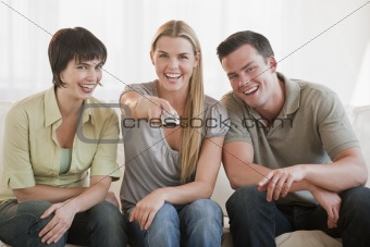 Group of friends watching television