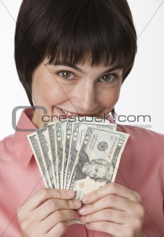 Beautiful brunette holding a stack of cash