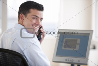 Attractive business man working on a computer