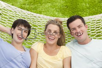 Group of friends lying together in a hammock