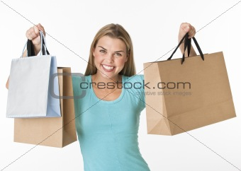 A young woman holding a shopping bags