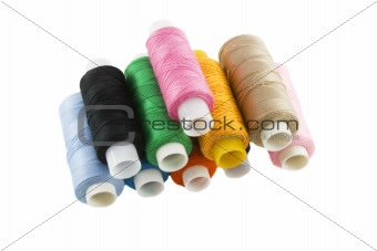 Many colorful threads over the white background