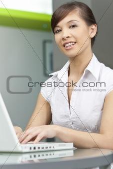 Beautiful Chinese Asian Woman Using A Laptop Computer
