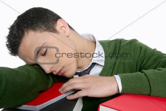 boy student sleeping over stack books over desk
