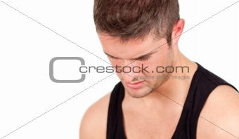 Portrait of anathletic man isolated on a white background