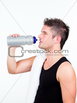 athlethic young man holding a sports bottle
