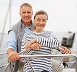 Happy senior couple enjoying vacation on sailboat
