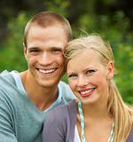 Closeup of a cute young couple smiling while outdoors
