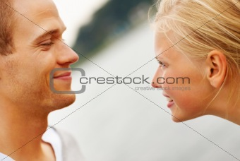 Closeup of a young couple looking at each other