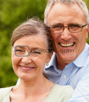 Portrait of a happy senior couple in garden