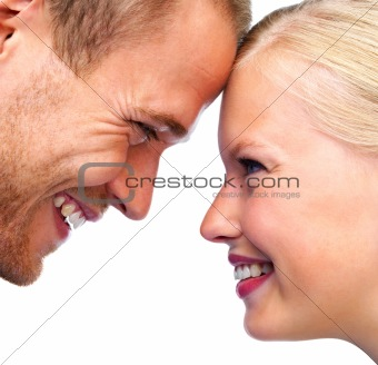 Happy young couple looking face to face at each other