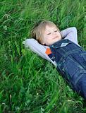 The boy on a green grass