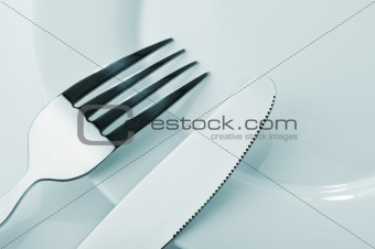 Knife and fork on a plate