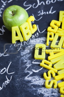 Alphabet and letters on a school blackboard