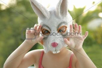 toddler girl with rabbit white mask