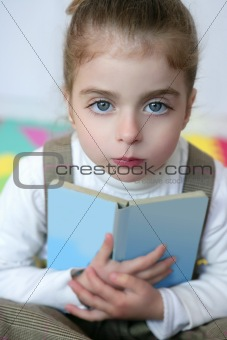 Beautiful preschooler girl studying book