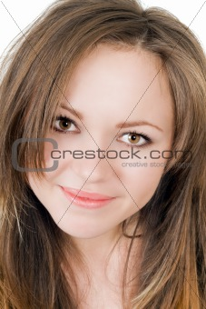 Portrait of the smiling young woman. Isolated on white