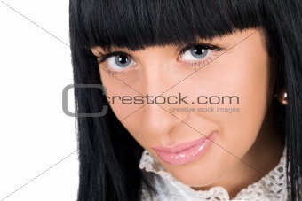 Portrait of the lovely young brunette. Isolated