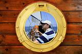 Sailor on sailboat, from boat round window