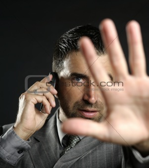 Angry businessman saying stop, hand