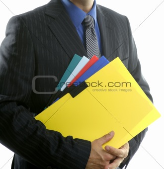 Businessman and color folders over white