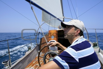 Sailor sailing in the sea. Sailboat over blue