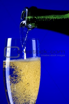 champagne glasses closeup on blue