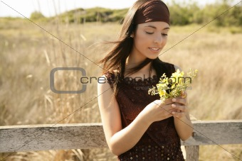 Beautiful woman in golden outdoor, yellow flower