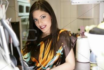 beautiful fashion woman on the kitchen