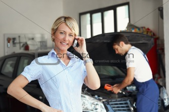 woman in auto repair shop