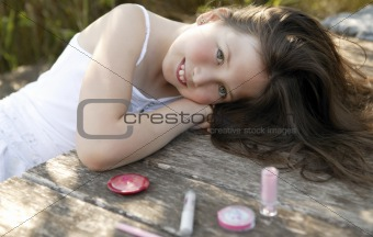 beautiful young girl with make up set outdoors
