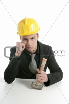 Architect with hammer and helmet, sad mood