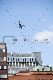 Airplane flying close to buildings