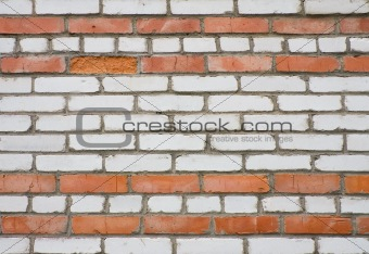 Old dirty white and red brick wall