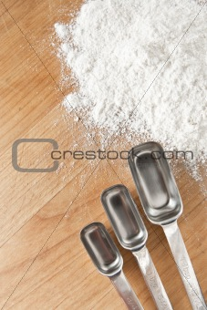 Measuring Spoons with Flour