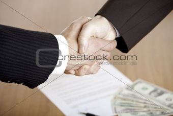 BUSINESS HANDSHAKE AFTER CONTRACT  Signature