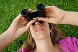 Woman binocular lenses grass