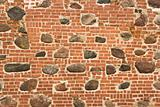 Brick wall with embedded stones