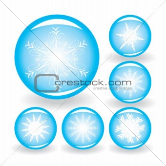 A set of buttons with white snowflakes