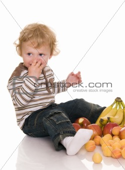 Baby with fruit.
