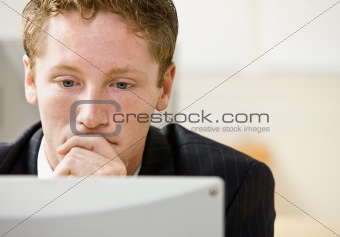 Businessman staring at computer