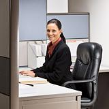 Businesswoman sitting at desk smiling
