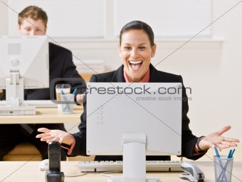 Businesswoman laughing at monitor