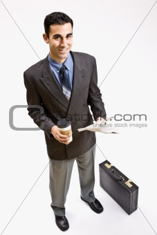 Businessman with coffee and newspaper