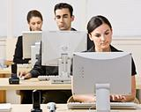 Business people working on computers