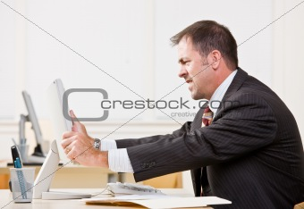 Businessman adjusting computer monitor