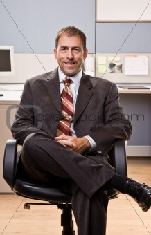 Businessman smiling sitting in chair