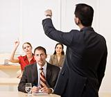 Businessman answering questions in meeting