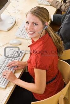 Businesswoman talking on headsets